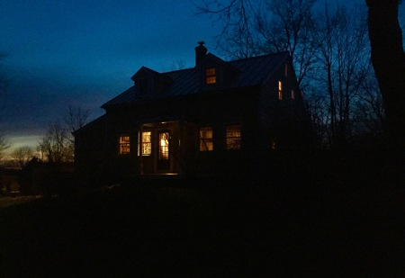 The house glows a little after dusk.